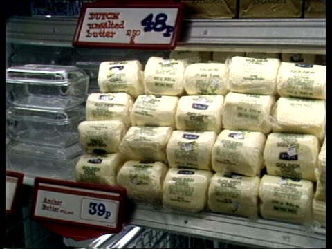 farm prices england ms woman at meat fridge ms packs of butter and price ms cheeses tms bags of sugar ms pan wrapped loaves - loaf stock videos & royalty-free footage
