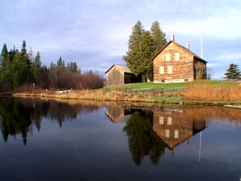 farm reflected in pond - artbeats stock videos & royalty-free footage