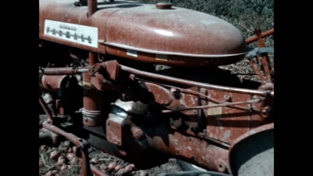 farmall 133 pulls a john deere potato digger in this archival film. - agricultural machinery stock videos & royalty-free footage