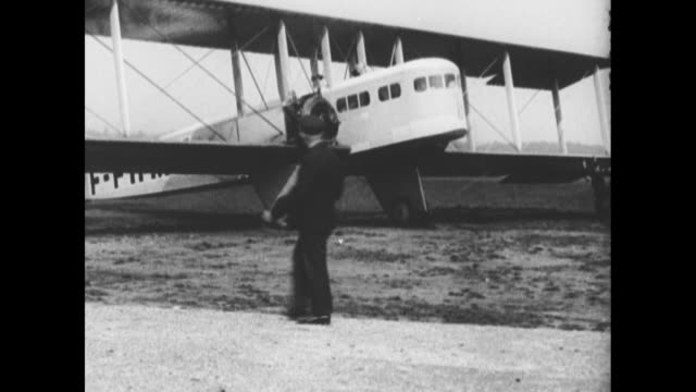 farman goliath airplane approaches on airfield with tail marking fffhmy / chalkboard displays arrivals of airplanes including the goliath /... - airplane tail stock videos and b-roll footage
