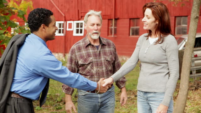 MS PAN Farmer and wife meeting banker / Warwick, New York,United States