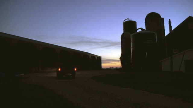 ws slo mo farmer arriving at dairy farm / columbus, wisconsin, usa - wisconsin video stock e b–roll