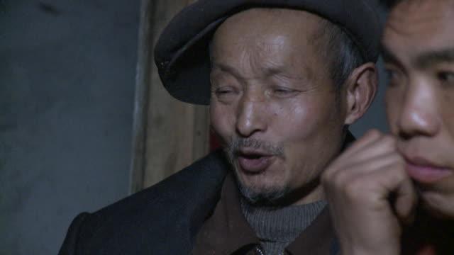 cu farmer at village meeting, datong, sichuan, china - schiebermütze stock-videos und b-roll-filmmaterial