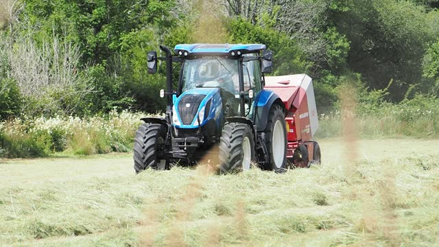 farmer baling hay in a traditional hay meadow in ambleside, lake district, on july 19, 2021 in ambleside, uk. - gardening stock videos & royalty-free footage