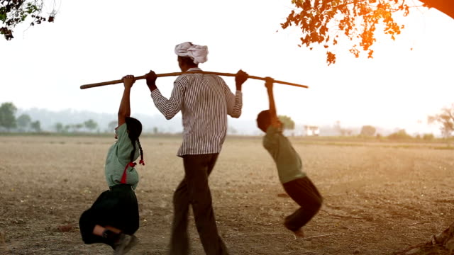 Farmer & children playing in the field