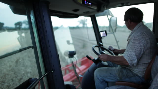 cu farmer driving combine harvester - agricultural equipment stock videos & royalty-free footage