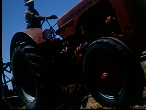cu, la, canted, farmer driving farmall tractor in field, 1950's, oklahoma, usa - 1953 stock videos and b-roll footage