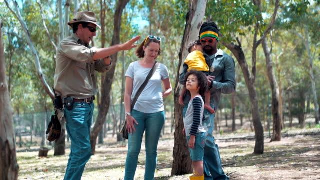 Farmer explaining about kangaroos on a tourist farm