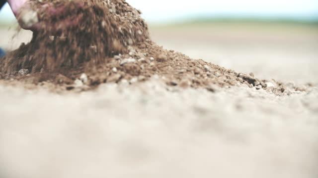Farmer holding soil in hands