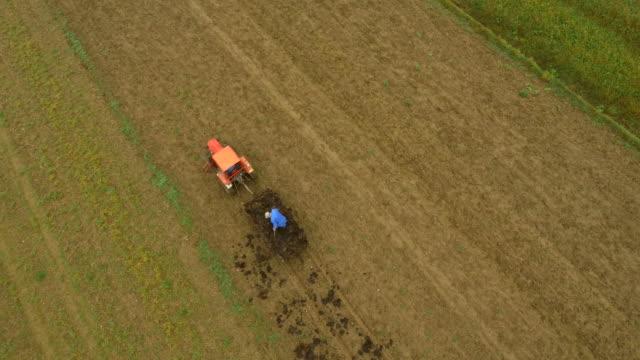 AERIAL Farmer Manure A Field