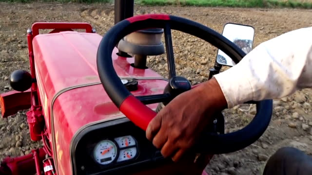 farmer plowing field outdoor in nature. - tractor stock videos & royalty-free footage