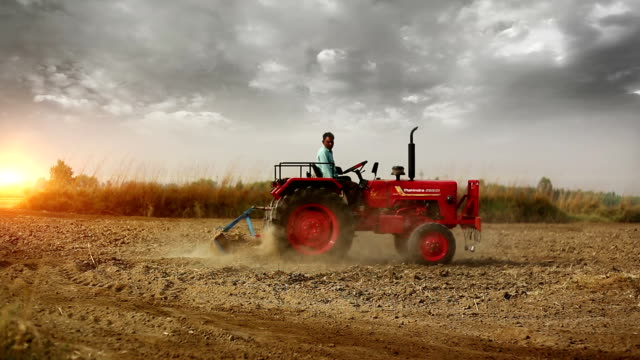 farmer plowing field - tractor stock videos & royalty-free footage