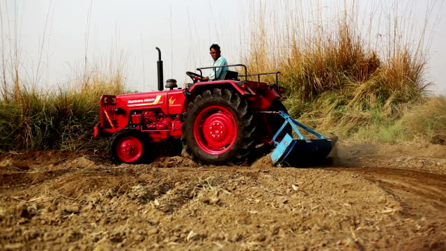 farmer plowing field - tractor stock videos & royalty-free footage