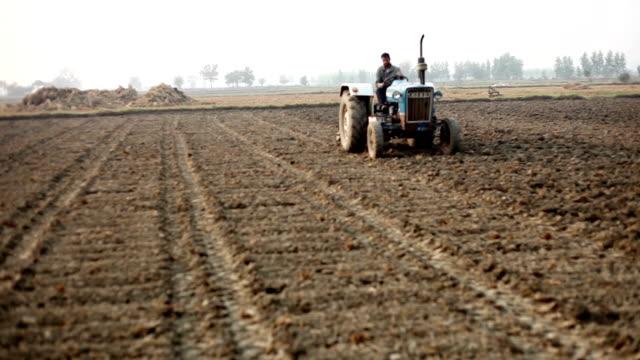 farmer plowing field - plowed field stock videos & royalty-free footage