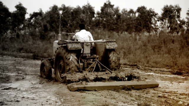 farmer plowing field - mud stock videos & royalty-free footage