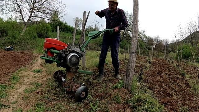 farmer plowing field - harrow stock videos & royalty-free footage