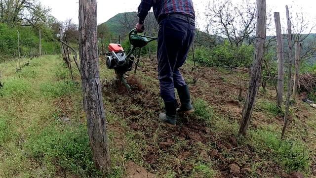 farmer plowing field with cultivator slowmotion - harrow stock videos & royalty-free footage