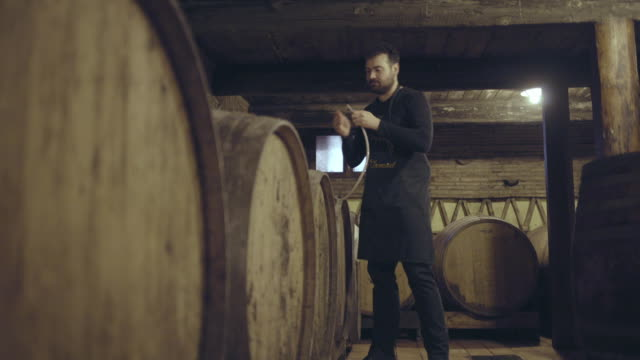 farmer pouring wine from barrel - viniculture stock videos & royalty-free footage