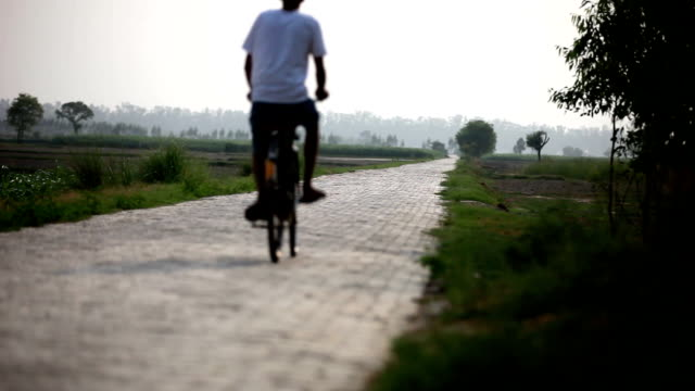 farmer riding bicycle to the field - indian ethnicity stock videos & royalty-free footage