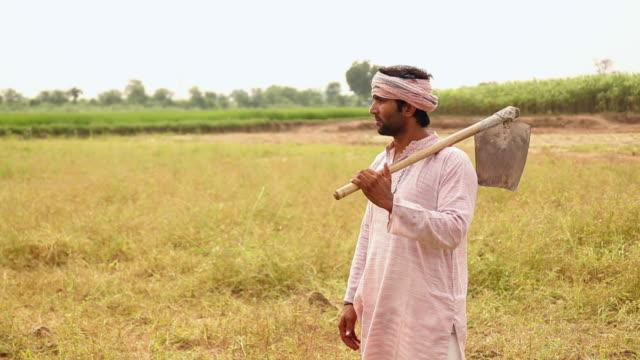 Farmer showing his farm to a businessman, Haryana, India