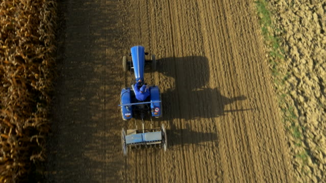 AERIAL Farmer Sowing The Field