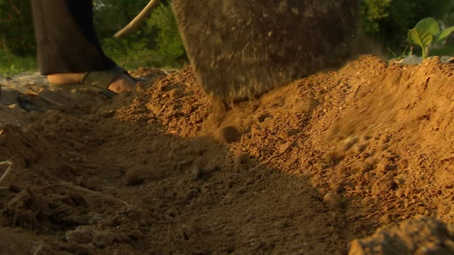 farmer tending soil on drought affected farmland jordan - farmer stock videos & royalty-free footage
