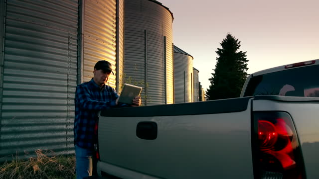 farmer uses a digital tablet to access the internet - pick up truck stock videos & royalty-free footage