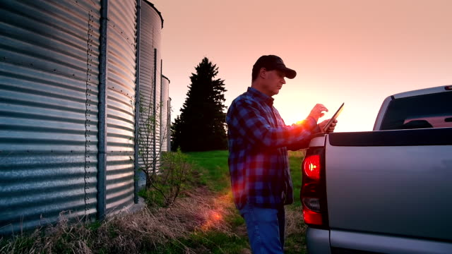 farmer uses a digital tablet to access the internet - truck stock videos & royalty-free footage