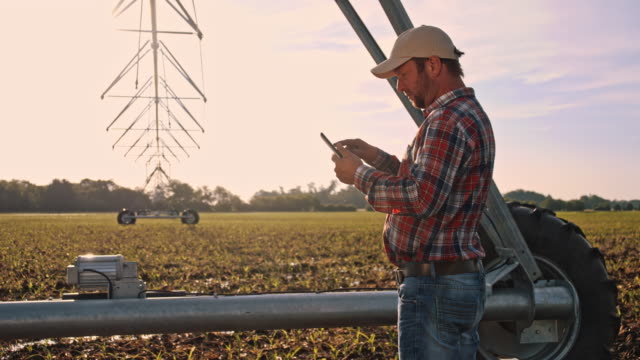 DS Farmer using a digital tablet on the field