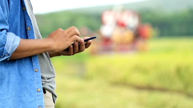 Farmer using smartphone, Slow motion