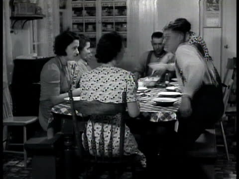 farmer walking w/ ox cart farmhouse w/ mountains bg int farmhouse family eating dinner at large table woman ladeling soup family portraits on wall... - 1943 stock videos and b-roll footage