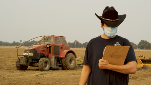 farmer worker wearing a protective face mask due covid-19 contagion prevention - cowboy hat stock videos & royalty-free footage