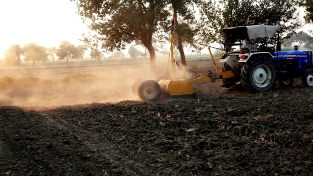 Farmer working in the field using tractor