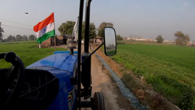 farmer working on farm in delhi, india - tractor stock videos & royalty-free footage