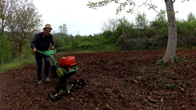 farmer working with roto tiller & cultivator - harrow stock videos & royalty-free footage