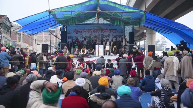 farmers blocked a highway as they sit on a protest against the central government's recent agricultural reforms, at tikri border, delhi on 09 january... - farmer stock videos & royalty-free footage