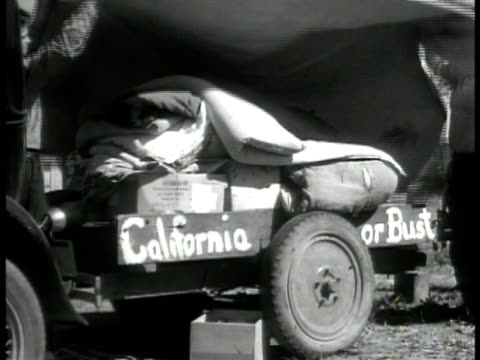 farmers covering truck w/supplies ms family on truck driving through now desert wasteland ws family sitting outside tent home shanty migrant workers... - 1910 stock videos & royalty-free footage