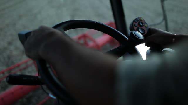 cu farmer's hands on steering wheel of combine harvester - combine harvester stock videos & royalty-free footage