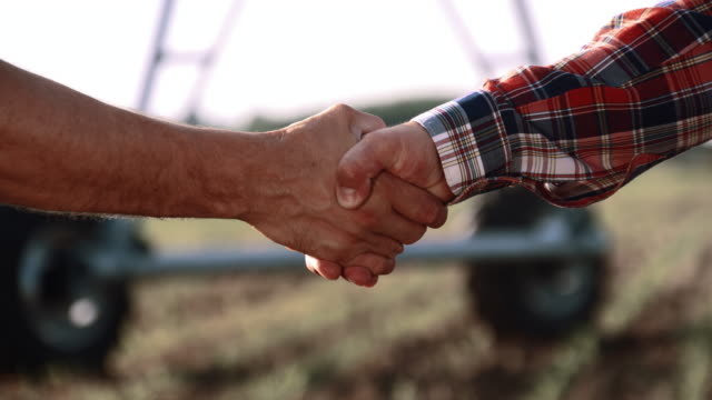 MS Farmers handshaking in the field