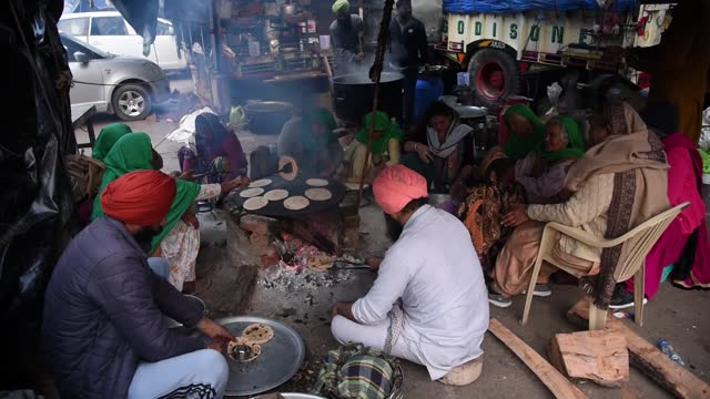 farmers making roti at a blocked highway as they sit on a protest against the central government's recent agricultural reforms, at tikri border,... - india stock videos & royalty-free footage