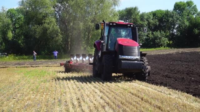 Farmers plough a field following a wheat harvest in Chernihiv Ukraine on Thursday Aug 10 2017