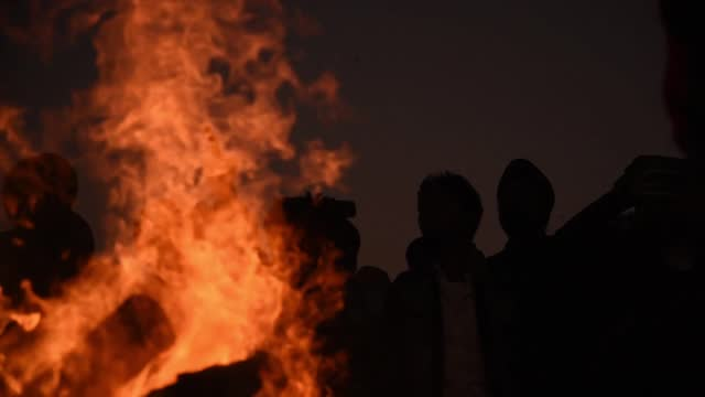 farmers shout slogan against indian prime minister narendra modi as they celebrate the lohri festival, at the site of farmers protest against the new... - farmer stock videos & royalty-free footage