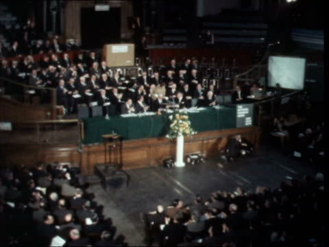 london westminster central hall gts meeting applauds cms placards unrolled from balcony pull out tms sir gwilym williams speaking sof ekt 16mm itn 30... - jahreshauptversammlung stock-videos und b-roll-filmmaterial