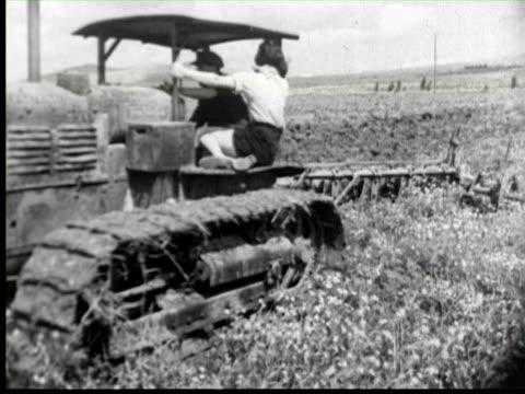 b/w cu farmers using machine in land, palestine / audio - pflug stock-videos und b-roll-filmmaterial