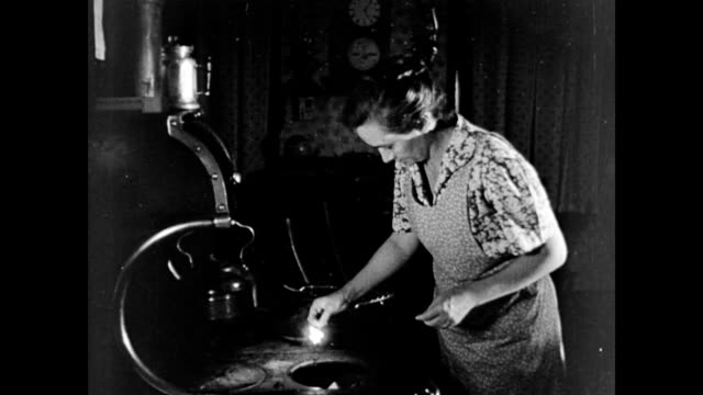 farmer's wife, hazel parkinson, pumps water / lights the stove / boy carries logs to mother / smoke comes out of chimney. early morning household... - fuel and power generation stock-videos und b-roll-filmmaterial