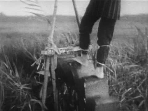 farmers working in rice field/ irrigation system - japan stock videos & royalty-free footage