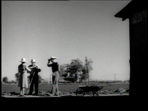 1949 montage farmers working their land and setting up posts for a fence in rugged country / nevada-arizona, united states - us state border stock videos & royalty-free footage