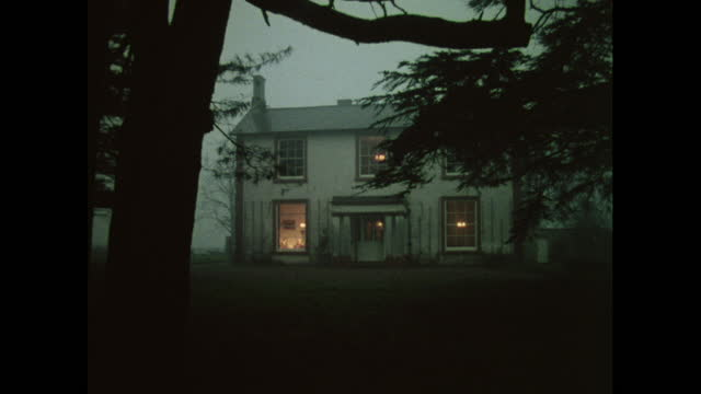 stockvideo's en b-roll-footage met farmhouse at twilight, uk, 1970s - dusk