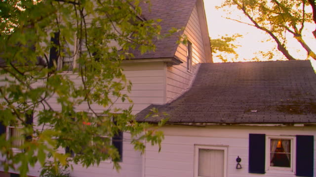 Farmhouse building exterior at dawn, jib shot