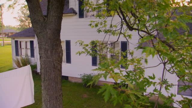 Farmhouse building exterior, pan